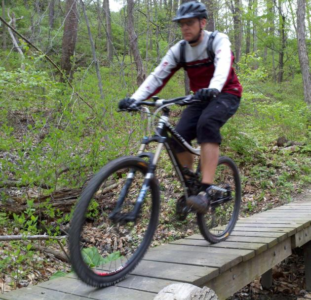 The author on one of the wooden bridges on the mountain bike trail in Cleveland Metroparks' Ohio & Erie Canal Reservation