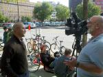 Christopher Alvarado, Board President of Bike Cleveland, speaks to a television reporter from Fox 8 News.