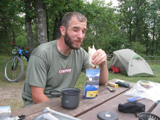 Brent enjoys dinner at the Tomahawk Creek Campground